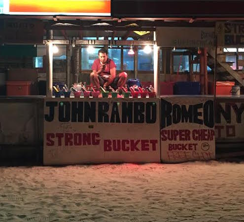 Many of the bucket booths have people's names on them, like Johnrambo and Anna (but we wouldn't have gone to Anna because she was tweezing her leg hairs over the buckets).