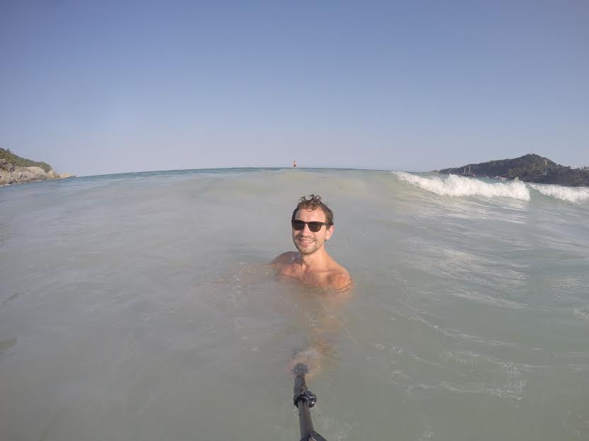 Daniel playing in the waves with his selfie stick (waves not pictured).