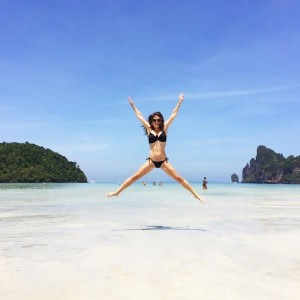 "Jumping Jaxy on Phi Phi island—Thailand's ""superstar""—land of warm water, scenic views, ""The Beach"", and poi"