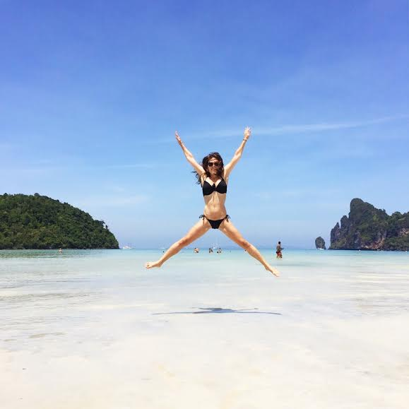 """Jumping Jaxy on Phi Phi island—Thailand's """"superstar""""—land of warm water, scenic views, """"The Beach"""", and poi"""