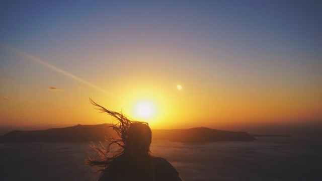Sunset and hair blowing in the wind