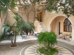 The courtyard at Casa Delfino Boutique Hotel